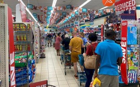 Long queues as more shops  open